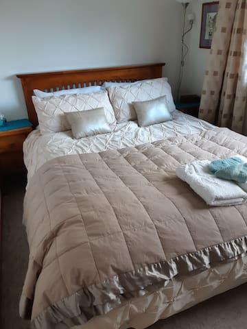 Comfortable queen bed in separate room