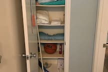 Things in the Hall closet.  Beach towels Beach bag Extra towels Extra comforter Broom Laundry pods Flash light Basketball  Tennis racket and balls
