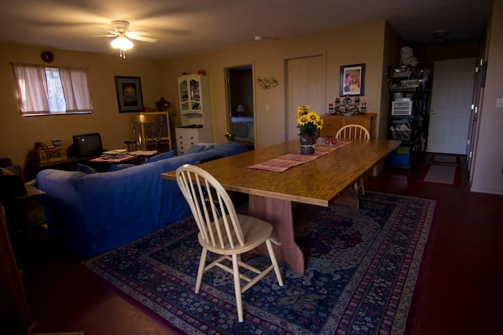 Spacious dining and living area with TV, Internet, books, games, magazines, and more
