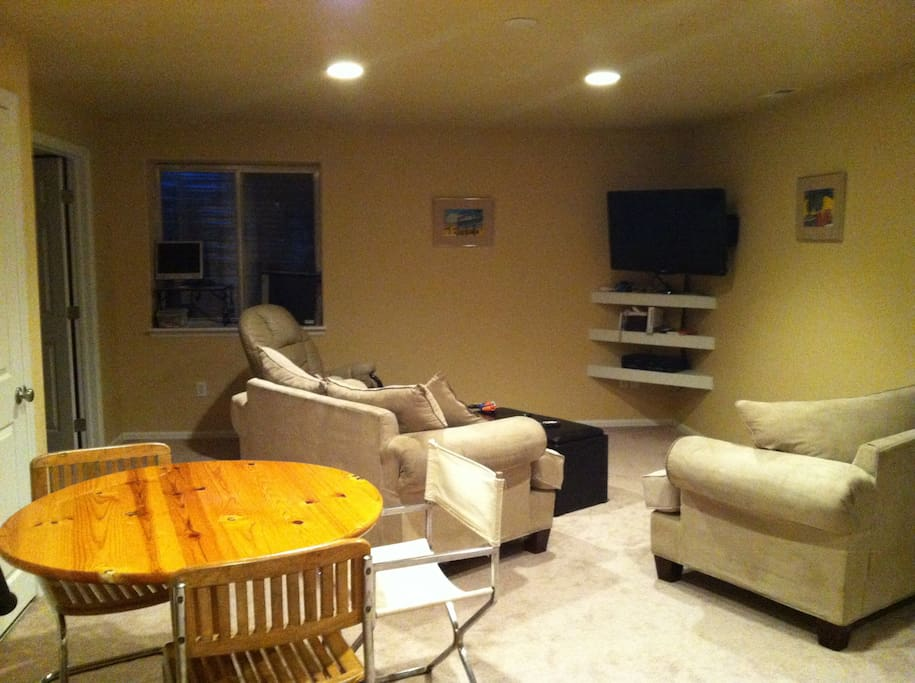 Comfortable living area with large TV and all the stations you could ever want including ESPN and HBO.