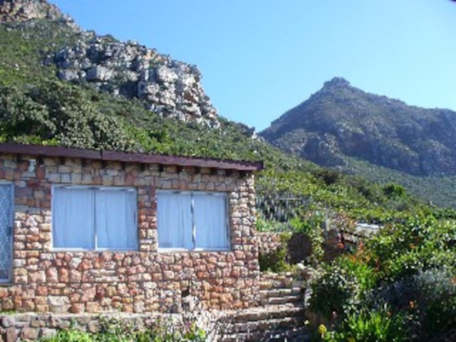 Stone cottage with Muizenberg mountain behind