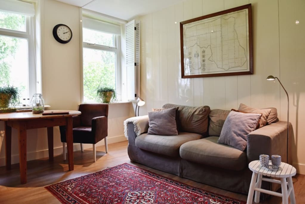 Your own living, with bookcase, TV, kitchen, dining table and sofa