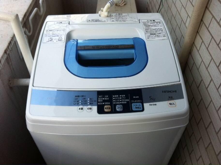 Washing machine on the balcony. Laundry liquid is provided