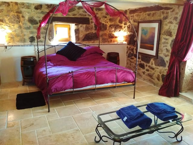 the red room with king size bed, sofa, en-suite shower room and outdoor seating
