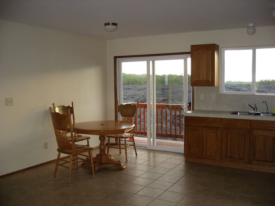 Kitchen / dining area with private deck.