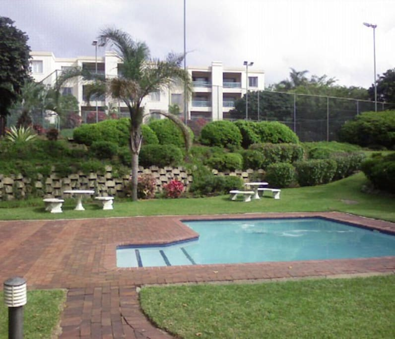 Beautiful gardens, swimming pools and barbecue areas in the property.