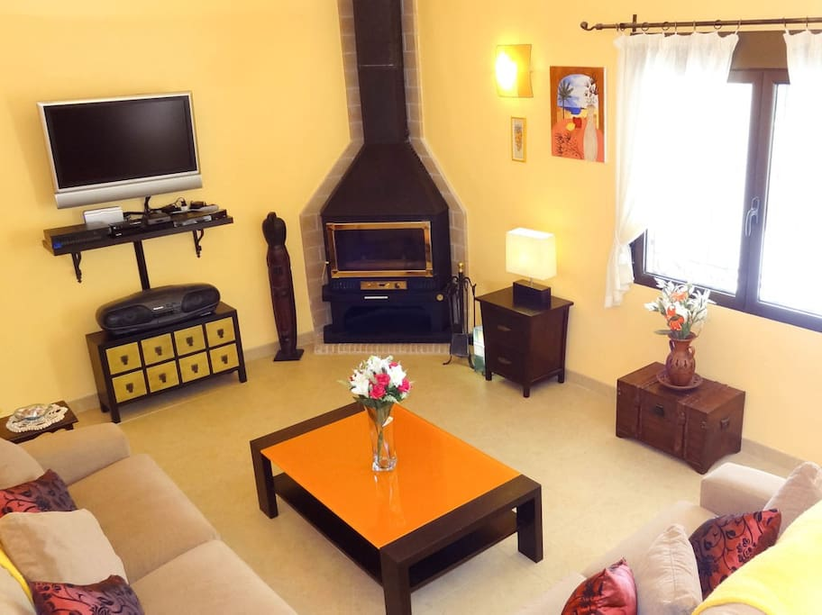 Living room with LCD TV, media player, DVD, and games console.