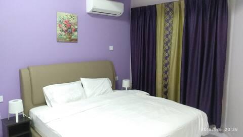 Shared Apartment at API-API  Center ( King bed R1)