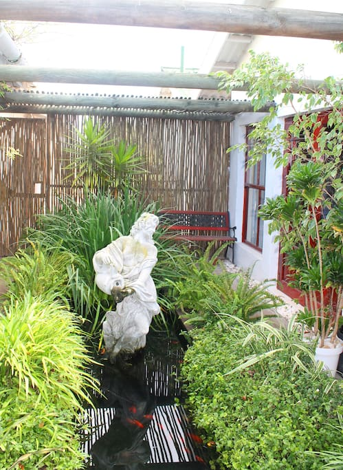 The garden with koi pond is shared by Ethnic Splendour and Golden Glen