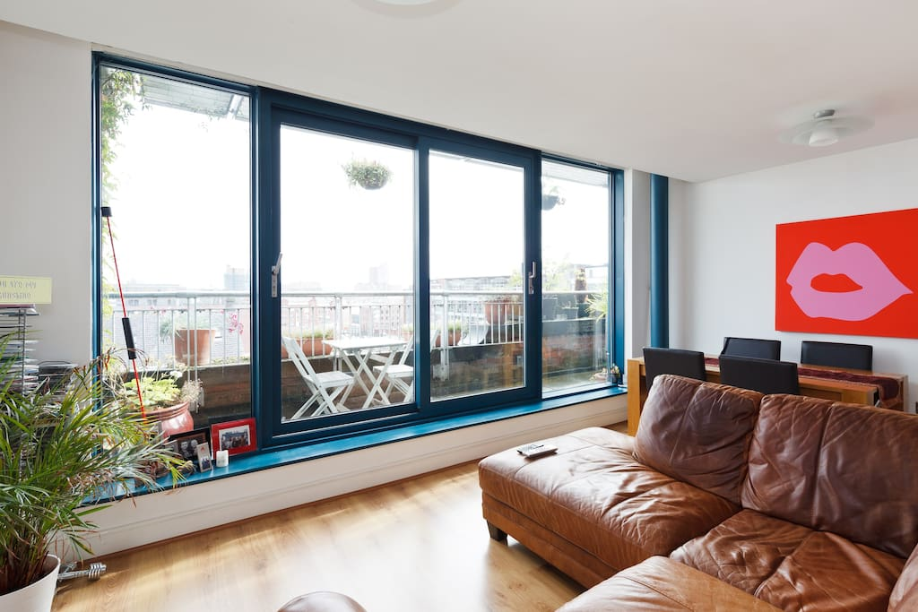 Living area with view over Manchester