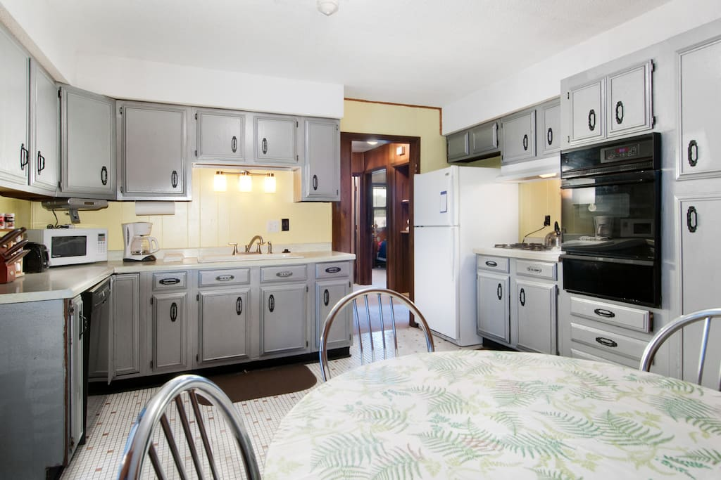 Kitchen picture showing all Cabinetry, and hall to bedrooms and bath