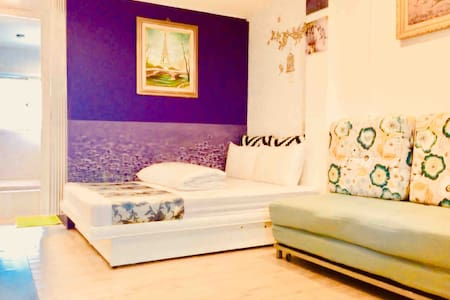 Living room have 1 x extra double bed with livingroom & sofa bed , TV , air condition & refrigerator +water/drinking/ fruit bar & garden view ........