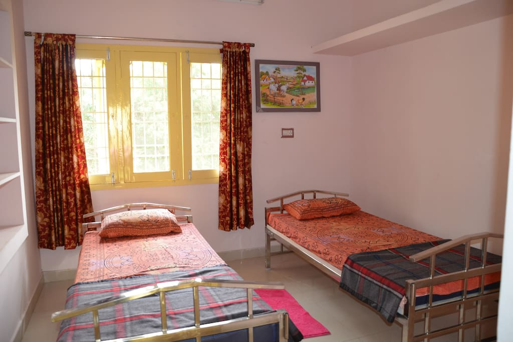 2nd Bedroom consists of two single bed and a fan