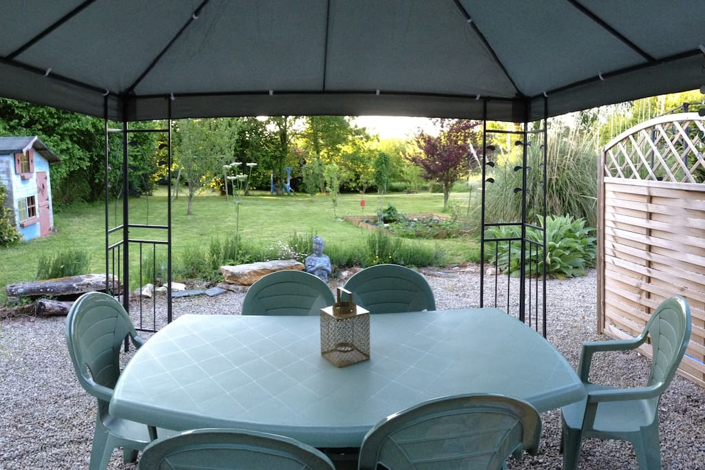 Private gazebo with table and chairs, chimie a and barbecue.