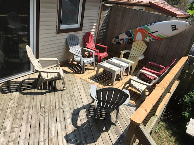 This BIG DECK has 10+ chairs with two distinct areas (lounging & dining) and it's perfect all day with it's combination of SUN & SHADE which is great for sun sensitive family members. There also many electrical outlets for charging devices.