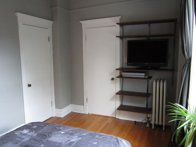 Bedroom(S.W.) Available - Queen bed, closet, shelves, TV/VCR/DVD