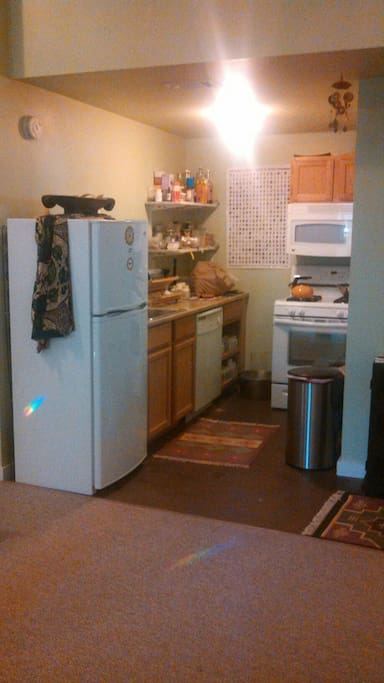 Kitchen with refrigerator, dishwasher, microwave furnished with some dried soup filtered water and gluten free staples for your visit.