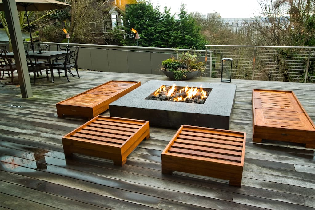 50 jet gas fire pit with seating area and view of sound