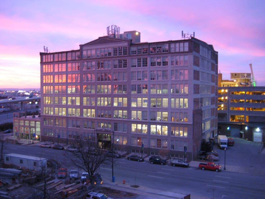 Glassworks Building exterior at sunset.