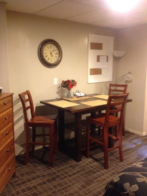 Comfortable table with chairs for dining or doing work
