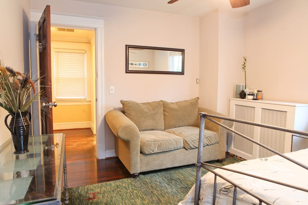 Sunny and large queen bedroom with loveseat, large closet and cable television