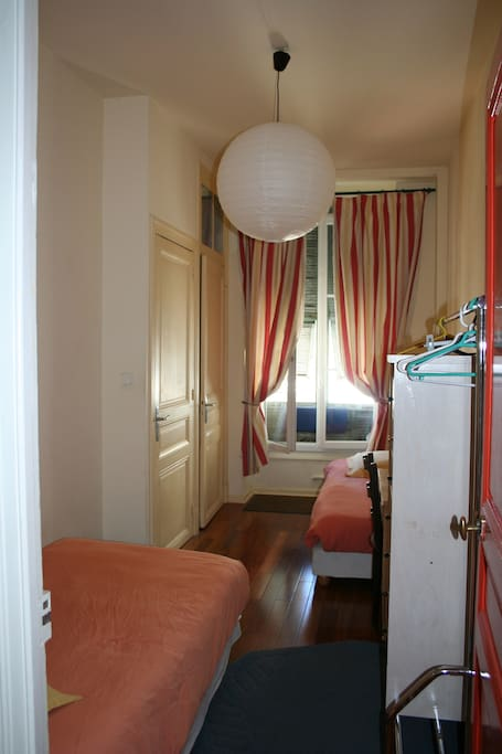 Bedroom for 2 (single beds) with private bathroom and toilets.