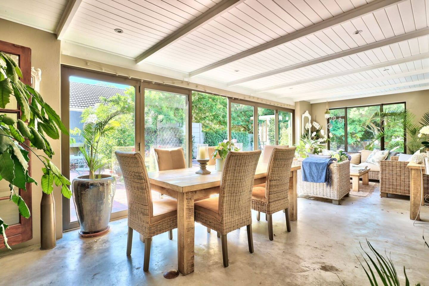 Sun Room looking onto pool and built-in barbecue area