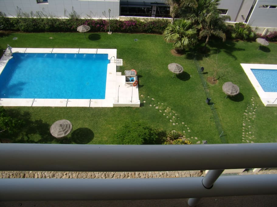 REAL VIEW FROM TERRACE. TWO POOLS AND GARDENS IN THE APARTMENT