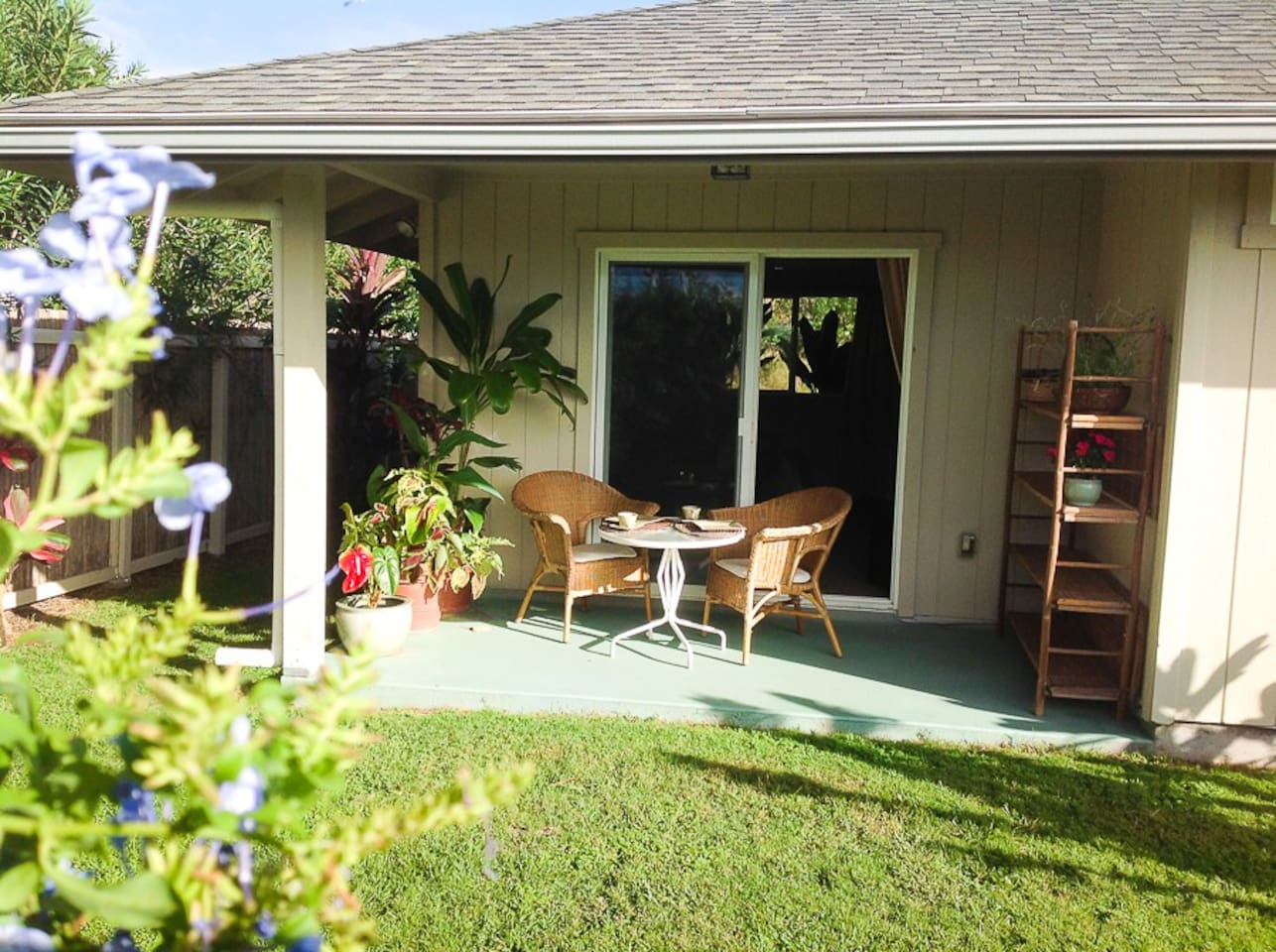 Your private garden porch opens up to lush landscaping and ocean views.