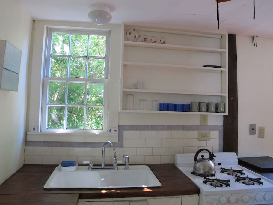 kitchen sink and window w/subway tiles