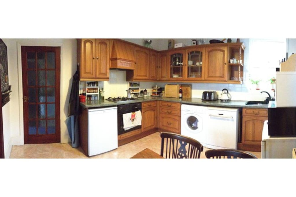 Gas hobs in a spacious kitchen.