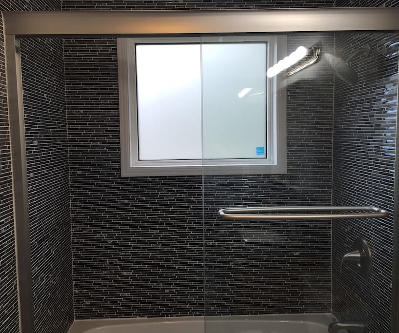 New shower highlights the remodeled bathroom.