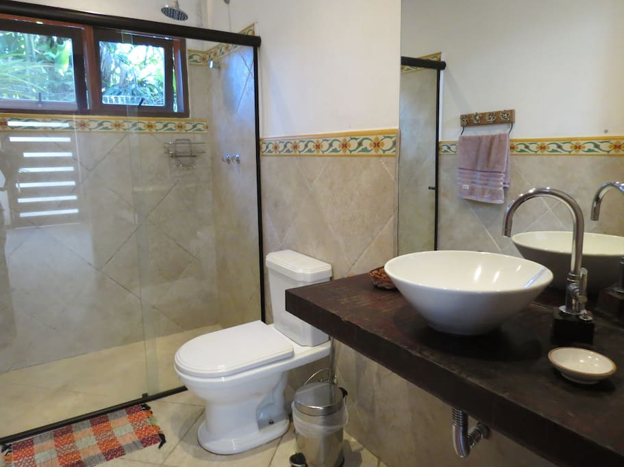 Shared bathroom with gas-heated shower