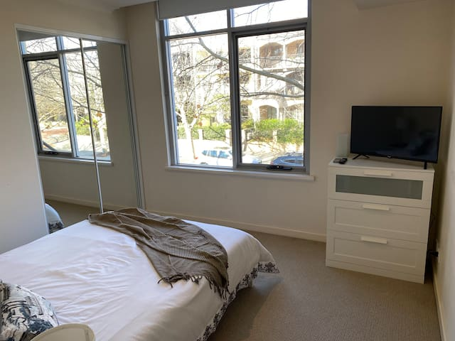 Main bedroom with view and Smart TV.