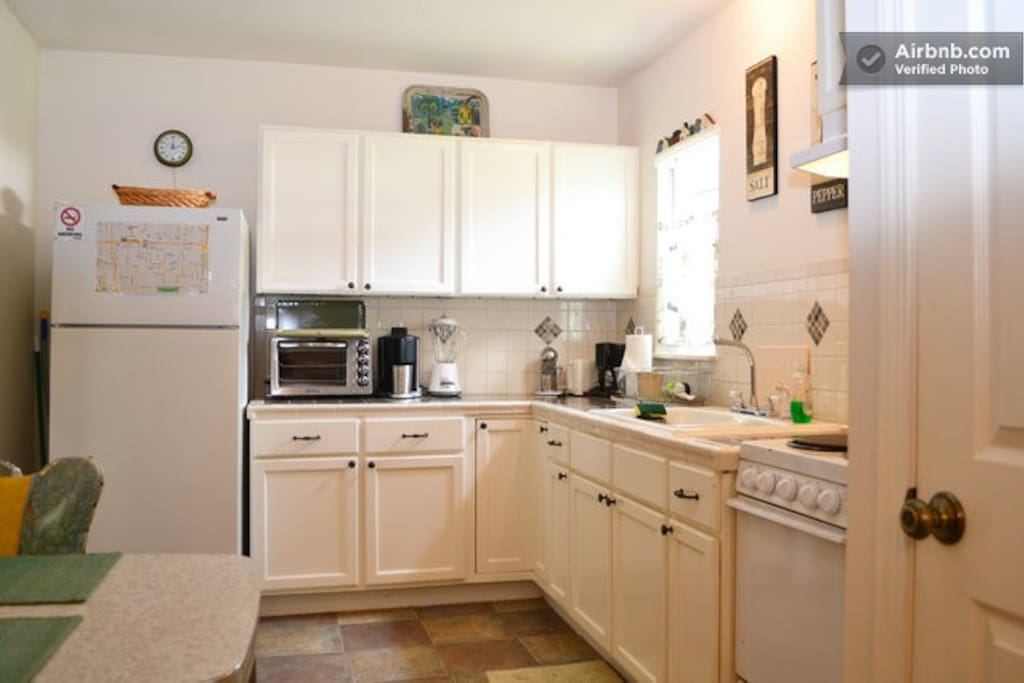 Full kitchen complete with cooking and eating utensils, juicer, blender, coffeemaker, toaster.