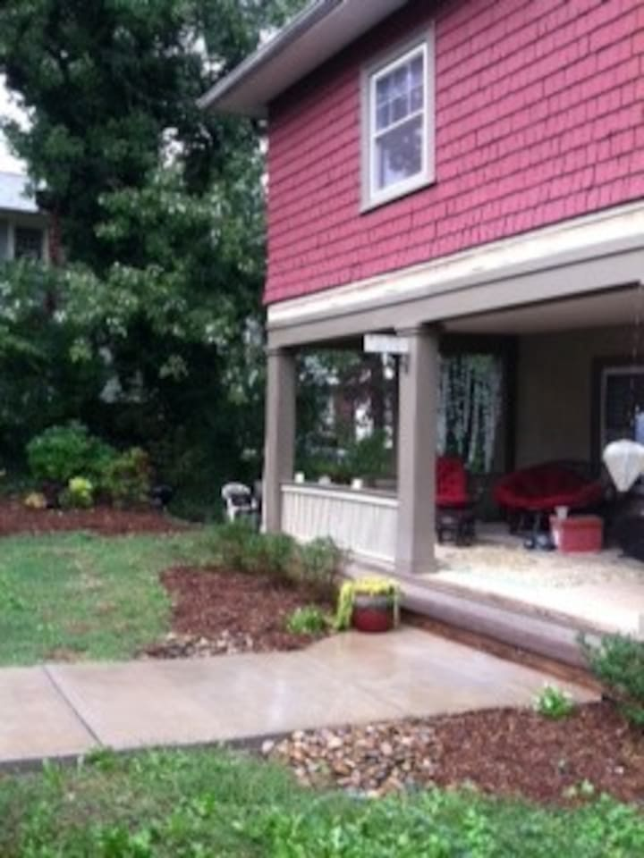 Covered front porch and side patio for barbecues and outdoor living.