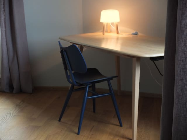 Retro simplicity - wooden table and butterfly chair from Ercol
