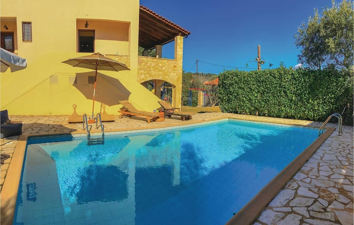 Amazing home in Aigio with Outdoor swimming pool, WiFi and 3 Bedrooms