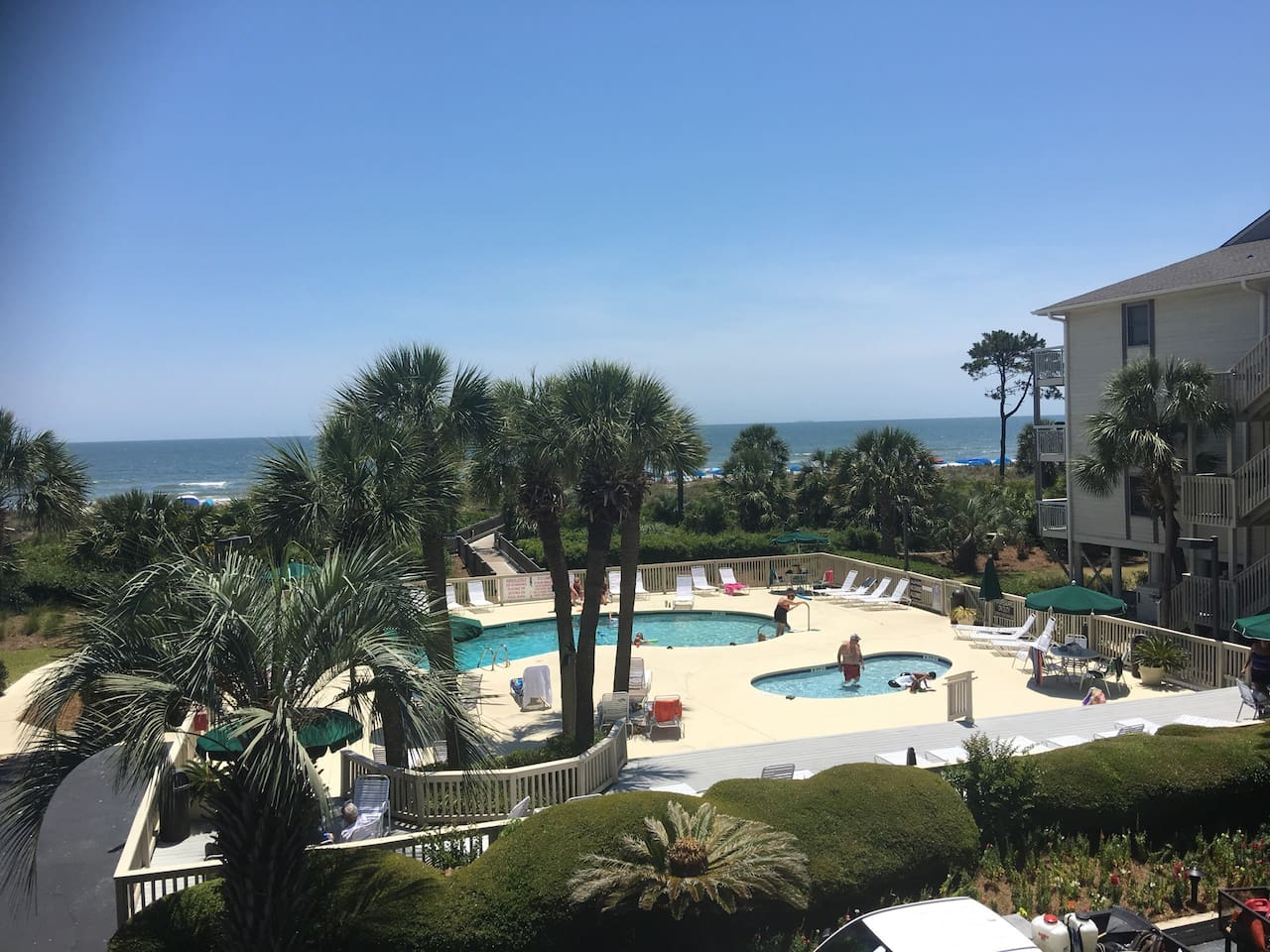 View from the Balcony - Ocean, Palm Trees and Heated Pool