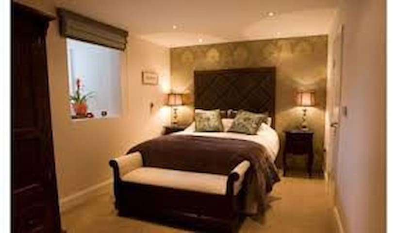 Main bedroom lower ground floor James Joyce room King Size bed