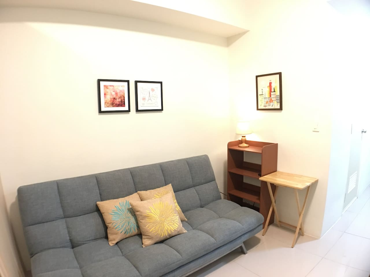 Enjoy watching in this cozy sofa