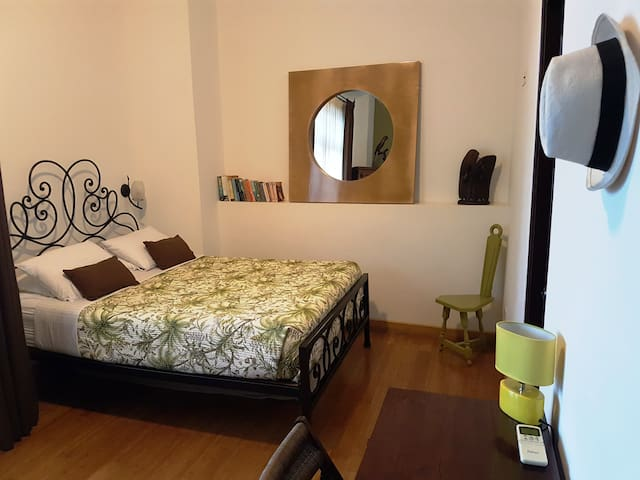 2nd bedroom on the main floor with its custom iron designed Queen size bed