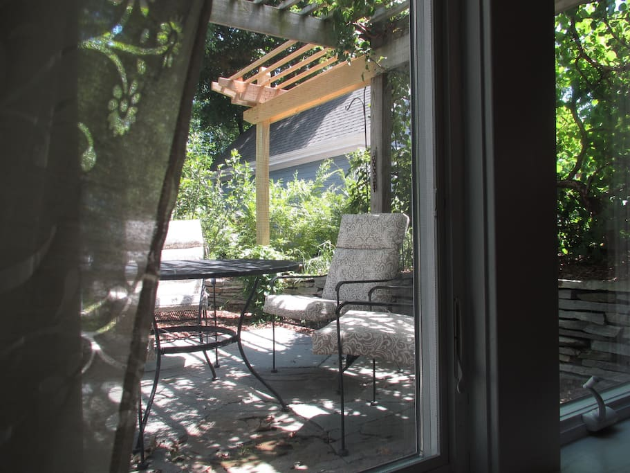 The large east windows look out onto the arbor and the fenced back yard and patio, yours to enjoy.