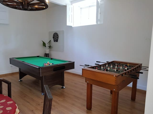 Foosball and snooker table at the Games Room