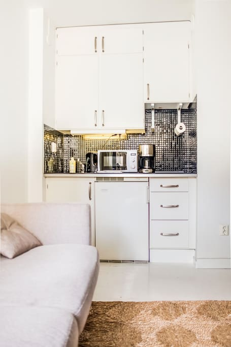 Kitchenette includes coffee brewer, micro, stove, fridge and kettle