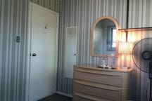 A large dresser and two mirrors for your convenience!