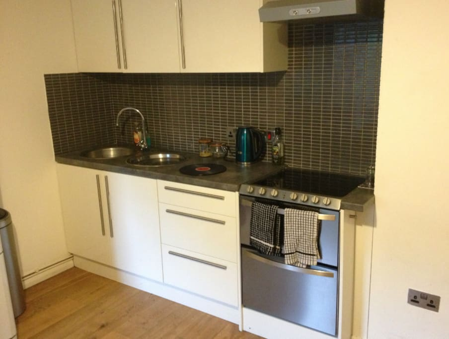 Everything you need is in the cupboards, and that's an oven/dishwasher combo on the right!
