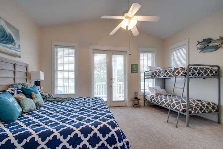 """Our Third Master Bedroom, on the second floor with a King bed (blue), and Twin over Twin bunk (gray), 55""""TV, Porch and Ensuite Bathroom"""