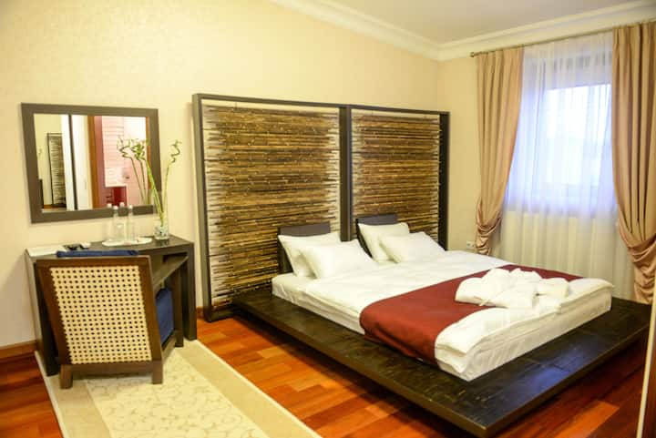 Sakura Queen Room in Premium Village Residence
