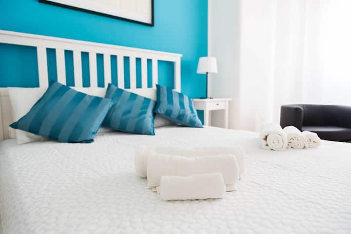 Elegante e confortevole camera in pieno centro